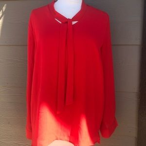 Bright red longsleeve, tie front blouse